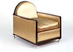 1925 (designed) armchair. Ruhlmann, Paris. Pearwood frame with silver plated brass feet and gold satin upholstery.  V&A museum