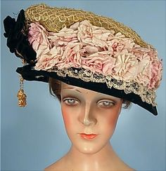 Circa 1909 All Original Huge Straw Horsehair Lampshade Hat Piled with Pink Silk Roses, Trimmed in Black Velvet with Ornament and Beaded Dangles.