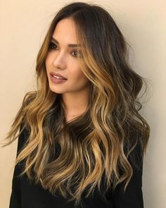 layered brown hair with golden brown highlights