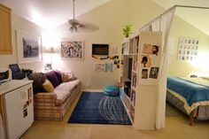Great Ikea hack--a faux dividing wall made of expedit units and pipes to hang a curtain.  Showing the living area side.