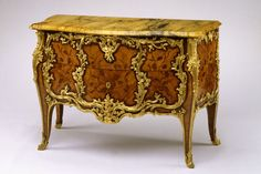 Joseph Baumhauer (French, died 1772), Commode, tulipwood and kingwood veneer, kingwood marquetry, gilded bronze mounts, marble top, about 1767–72, possibly a decade earlier.  Gallery 28B