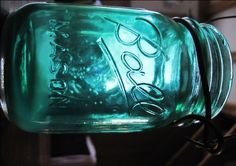 This started out as a clear glass jar.  A mixture of Mod Podge, a little water, some food coloring, and 20 minutes in an oven and POOF, mason jars in whatever color you want!