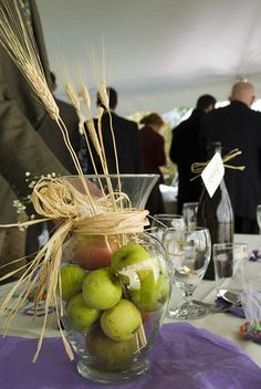 Clever centerpiece concept -- fill a vase with fruit in colors matching your wedding.  When the wedding's over, eat the fruit. :)