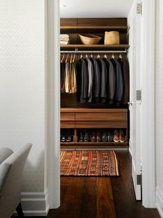 CLOSET WALL OPPOSITE ENTRY DOOR #1:  (not so much color - just general style - nicer materials, shoes at bottom, some wider drawers and a place to hang suits)  Haus Design: One Way-Cool, Totally Hip Bachelor Pad