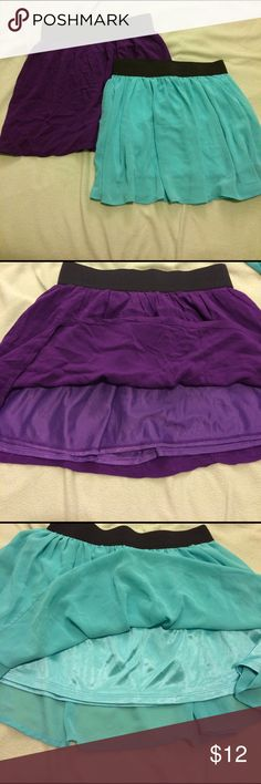 "Bundle of 2 skirts 2 cute skirts with black elastic bands. One is purple and one is an aqua color. Worn a few times but are both in good condition. Purple is a solid cotton fabric, while aqua is a sheer fabric. Both are 15"" in length. Waist band is elastic so it stretches! Both have a slip underneath so it is not see through. Would like to sell together. Women's medium. Forever 21 Skirts Mini"