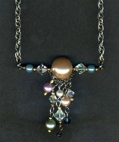 Necklace made from chain, faux pearls, crystal beads and seed beads from recycled thrift store necklaces.