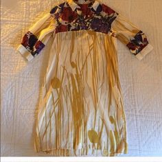 Dries van noten Designer Silk Dress Beautiful silk dress. Sized European 38 or medium - flows nicely very vivid color in print soft and lovely piece! Fits like a size 6 Dries van Noten Tops Tunics