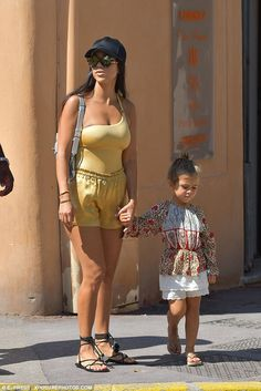 Golden girl!Kourtney Kardashian, 37, ensured all eyes would be on her as opposed to the landscape as she donned a showstopping gold ensemble to visit St Tropez on Tuesday