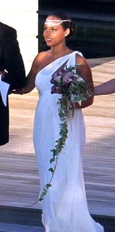 Alicia Keys was married to Swizz Beatz on July 31 in a secret ceremony in Corsica, France. Her dress, a Greek goddess inspired ivory silk gown, really completes the Mediterranean Sea theme of her wedding.
