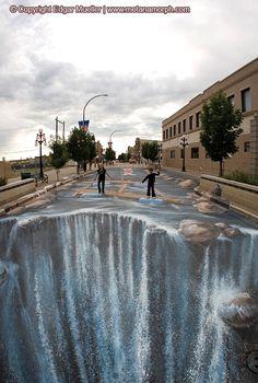Sidewalk art. I would look stupid walking on this.