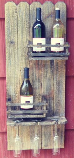 """Beautiful rustic wine rack designed to hold up to four bottles of your favorite wine and three wine glasses that suspend from the bottom. Shelves resemble old wooden crates and compliment your bottles beautifully. Shelf is 35.5"""" tall and 14.5"""" wide. Shelves are approximately 8.5"""" wide and 4"""" deep. Hangs with included hangers."""