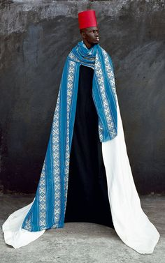 Maïmouna Guerresi  who was born in Italy as Patrizia Guerresi where she was raised as a Catholic. She later changed her name when she married a Senegalese man, and converted to Sufi Islam.