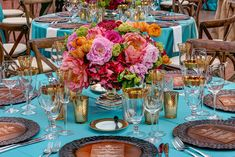 Floral bouquets featuring pink, orange, and green blooms decorated dinner tables. #centerpiece Photography: Jerry Hayes Photography. Read More: http://www.insideweddings.com/weddings/outdoor-spring-wedding-celebration-on-a-ranch-in-texas/637/