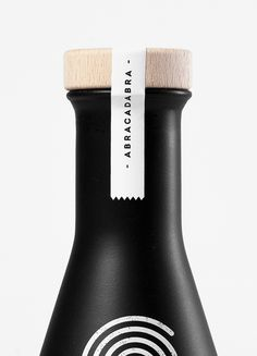 Black Bottles Container Graphic design icon Logo Matte Packaging paint Rounded Wood