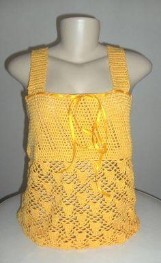 Blusa regata em Crochet Sun | Tita Carré | Elo7. Blusa regata em Crochet Sun, R$ 143,00 ou 12x de R$ 15,68 no cartão. Blusa Regata feita com linha fina em crochet com acabamento em fita de cetim tamanho 42, pronta entrega.
