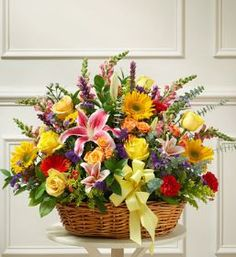 Bright Flower Sympathy Arrangement in Basket In times of sorrow and loss, finding the perfect expression sympathy can be very difficult. Let them know there are brighter days ahead with this basket fu