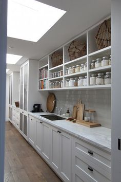 Over two years ago I wrote a post about some lovely storage jars I'd found. I also wrote about my dream of having a blow-your-mind pantry and laundry one day. The architect we chose has a reputation f