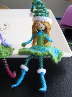Yarn and pipe cleaners - pipe cleaner dolls