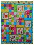 Bring the zoo to your little one! This quilt measures 48 x 57 and is done in bright fabrics. Trim it in pink, blue or yellow! Kit includes FREE patter, fabric for top and binding. Price includes tax, shipping and handling.