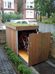 Green roof bike shed - sliding rails storage