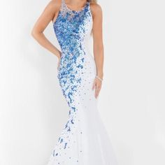 Prom dress! beautiful dress with bateau, white lining bodice, and shimmering contrasting beading on one side of this gorgeous mermaid gown. The sheer and beaded back adds elegance to this beautiful Rachel Allan gown! rachel allan Dresses Prom