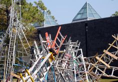 """Wilmington artist Charlie Brouwer assembling """"Rise Up Wilmington,"""" a ladder installation on the grounds of Cameron Art Museum. It involves more than 250 ladders."""