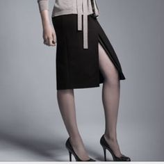 """Elie Tahari Exclusive Nordstrom Julie Knit Skirt Stunning, sleek, and sexy! Black knit with black leather trim peeking out from slits in front and back. Love this skirt! Worn once, like new. 10% OFF BUNDLES ❌NO PP, TRADES, HOLDS. PLEASE SUBMIT REASONABLE OFFERS THROUGH """"OFFER BUTTON""""❌ Elie Tahari Skirts Pencil"""