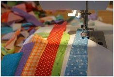 This is an amazing strip quilt tutorial.. How to sew  the string blocks together.