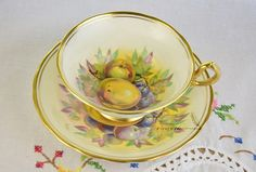 Signed Royal Chelsea tea cup and saucer fruit decoration