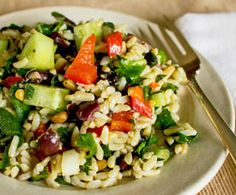 Mediterranean Rice Salad: With video! One of our fave easy summer recipes, perfect to make ahead and chill to serve later, or take to work or school.This is a big salad, although it's easy to make half the recipe.