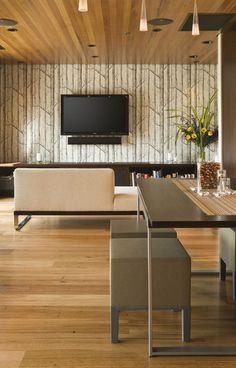 Clean lines everywhere. The height that the Woods wallpaper gives this room is continued by the paneling on the ceiling. Everything is elongated. Woods is available at walnut wallpaper #wallpaper