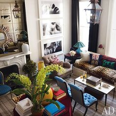 Very sophisticated combination of color, style, accessories and amazing black & white wall art/photos.