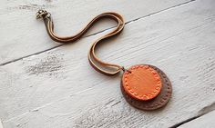 Handmade leather pendant necklace. Leather jewelry. Boho necklace. Brown necklace. Orange necklace. Bohemian jewelry. by VelmaJewelry on Etsy https://www.etsy.com/listing/200596295/handmade-leather-pendant-necklace