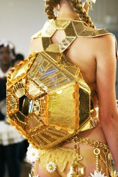 Futuristic gold backpack.  Burning Man Festival,  here she comes! Enjoy RUSHWORLD boards, HANDBAG HEAVEN, UNPREDICTABLE WOMEN HAUTE COUTURE and WEDDING GOWN HOUND. Follow RUSHWORLD! We're on the hunt for everything you'll love!