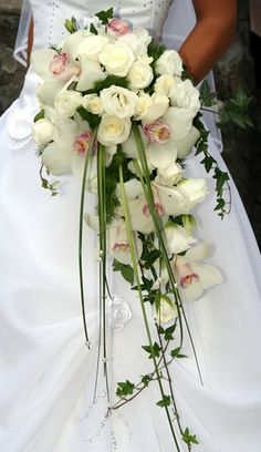 I like the simplicity of this one's size, but with green hydrengeas, orange roses, white sweet peas, and blue ribbon