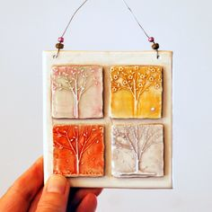Ceramic Wall Hanging, Four Seasons, Trees, pink yellow, orange, blue. $14.00, via Etsy.