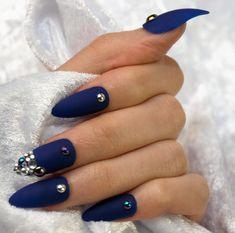 Matte cobalt blue stiletto nail finished with rhinestones galore, Ariel is a beautiful nail set that compliments most looks and skin tones! www.cachitonails.com #manicure #nails #beauty #nailart #3dnails #love #makeup #nailart #stylish #cobalt #blue #mattenails #nailstoinspire #nailinspiration