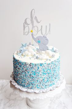 elephant baby boy cake elephant baby boy cake Related FUN Baby Shower Games - Southern Dakota MamaPlanning a Baby Shower? 3 Tips For Throwing a Wonderful Baby Shower How t. Elephant Baby Boy, Elephant Baby Shower Cake, Elephant Cakes, Baby Shower Cakes For Boys, Baby Boy Cakes, Elephant Party, Babyshower Cake Boy, Cake For Baby, Baby Boy Christening Cake