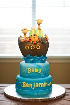 Noah's Ark Baby Shower Cake Babyshower cake made to match the Noah's Ark invitation. Top tier is all fondant laid to dry. Tfl!