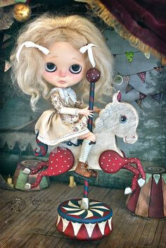~ The Carousel Horses ~ Rebeca Cano presents her new works The Carousel Horse Fantasy Ciscus pink & red The Carousel Horse Antique Circus white & red Unique pieces designed and handmade in wood. Provided with a rotating musical mechanism with a theme of Mozart. www.cookie-dolls.com