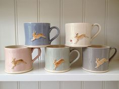 Jumping Hare Mugs by Jane Hogben