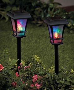 add light in a rainbow of colors to your yard with this set of 2 solar accent