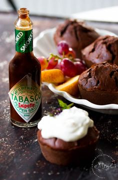CHOCOLATE MUFFINS WITH A HINT OF TABASCO | CHILISUKLAAMUFFINSSIT Chocolate Muffins, Chipotle, Sauce Bottle, Soy Sauce, Baking, Desserts, Food, Chocolate Chip Muffins, Tailgate Desserts