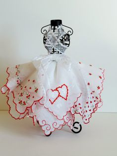 Use wired dress form and stuff points of hankies into wire holes to make a hankie dress- great idea