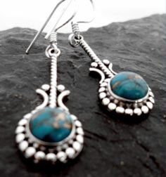 $34.00~Sterling Silver Long Drop Earrings with Round Mohave Turquoise Cabochon ~Designed in India~click on the following link for more details for these earrings: http://www.silverjewelry-sterling.com/earringsindia/Sterling-Silver-Drop-Mohave-Turquoise-Earrings.html#.UWIq3aZvCVg