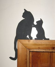 Cute black cat and kitten silhouette that is designed to sit on the tops of doors. Description from rustic-crafts.co.uk. I searched for this on bing.com/images