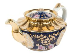 A RUSSIAN PORCELAIN TEAPOT WITH FLORAL DESIGN, POPOV PORCELAIN FACTORY, MOSCOW, FIRST HALF 19TH CENTURY  of softly lobed form, with hand-painted gilded flowers and leaves sprays to a blue ground, with gilded handle, spout, and accents, the cover with conforming decoration, height: 12 cm (4 3/4 in.), lenght: 22 cm (8 5/8 in), blue underglazed mark on base.