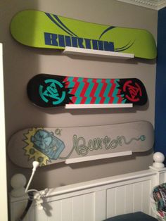 Snowboard display; hanging snowboards; Burton; K2; Ikea Ribba shelves; boys bedroom decor