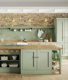 Discover how to use the on-trend, earthy tone of sage green in your home to create a stunning contemporary look with a natural edge. Sage Green Kitchen, Green Kitchen Decor, Green Kitchen Cabinets, Kitchen Cabinet Colors, Home Decor Kitchen, New Kitchen, Home Kitchens, Kitchen Design, Sage Green House