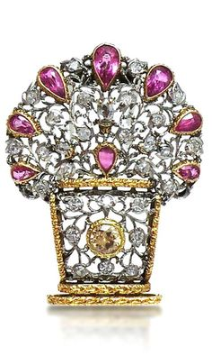 AN 18K WHITE AND YELLOW GOLD BROOCH SET WITH RUBIES AND DIAMONDS, SIGNED MARIO BUCCELLATI